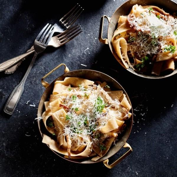 2 bowls of papperdelle pasta with mushrooms and cheese